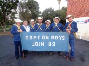 Coo-ee marchers at Dubbo Anzac Regional Sleep Out parade 24/4/2015 – (from left) Stephen Thompson, Geoff Kiehne (support), Bruce Tyler, Eric McCutcheon, Don Kenaugh, Stuart Moore, and Brian Bywater (Photograph: H. Thompson 24/4/2015)
